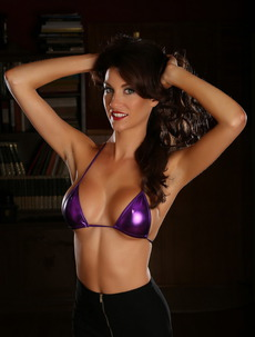 Alluring Vixens: Stunning Busty Alluring Vixen Tease Bethany Shows Off Her Big Boobs In A Skimpy Shiny Purple String Bikini Top