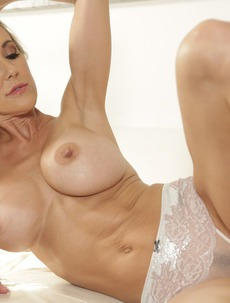 Naughty MILF Brandi Love Strips On The Couch