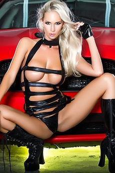 Andrea Jarova Pose On Supercar