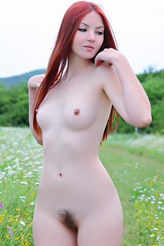 Lusty Redhead Seductive Outdoors